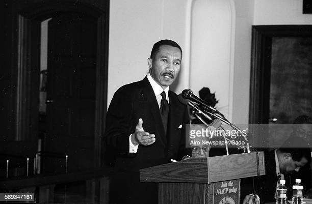 Kweisi Mfume delivering a speech at the podium 1987