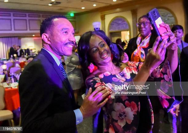 Kweisi Mfume poses for a picture with Tenia Allen of Baltimore in Baltimore MD on December 8 2019