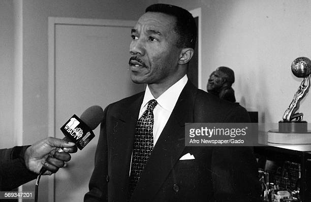 Kweisi Mfume speaks into a microphone as he answers questions from the press 1987
