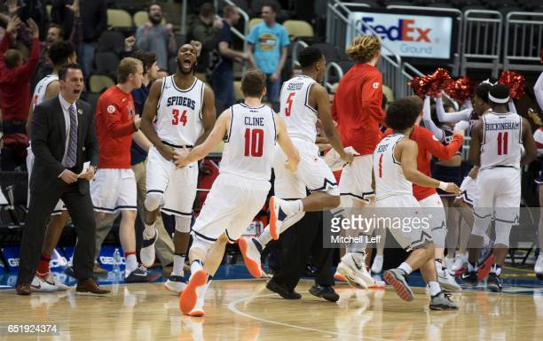 Kwesi Abakah TJ Cline Nick Sherod Joe Kirby and De'Monte Buckingham of the Richmond Spiders celebrate at the end of the game against the George...