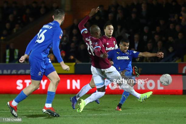 Kwesi Appiah of AFC Wimbledon scores his team's first goal during the FA Cup Fourth Round match between AFC Wimbledon and West Ham United at The...