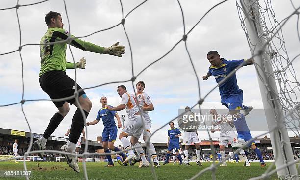 Kwesi Appiah of AFC Wimbledon scores Wimbledon's first goal during the Sky Bet League Two match between AFC Wimbledon and Newport County at The...