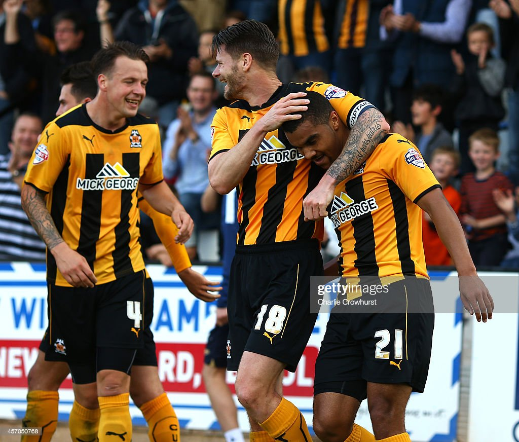 Kwesi Appiah of Cambridge celebrates with team mate and captain Michael Nelson after scoring his and the teams second goal of the game during the Sky Bet League Two match between Cambridge United and Oxford United at The Abbey Stadium on October 11, 2014 in Cambridge, England.
