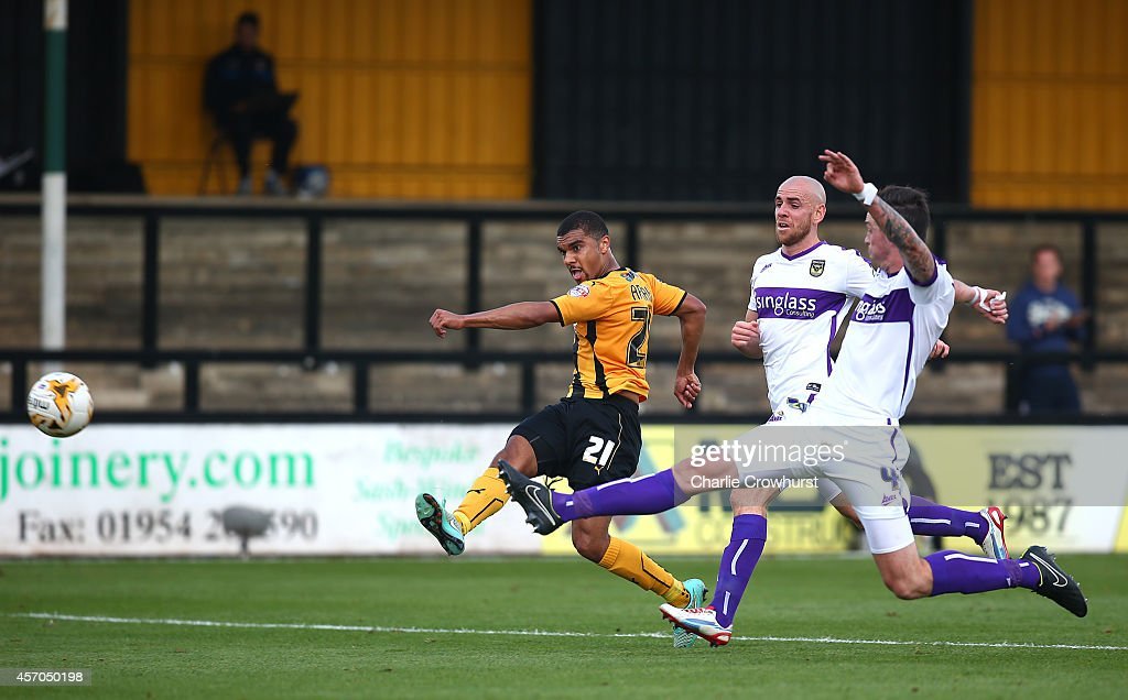Kwesi Appiah of Cambridge scores his and the teams first goal of the game during the Sky Bet League Two match between Cambridge United and Oxford United at The Abbey Stadium on October 11, 2014 in Cambridge, England.