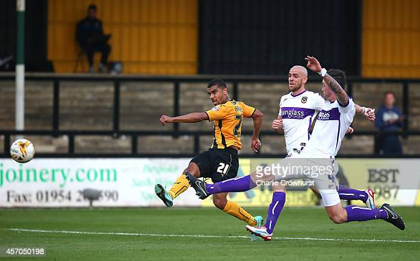 Kwesi Appiah of Cambridge scores his and the teams first goal of the game during the Sky Bet League Two match between Cambridge United and Oxford...