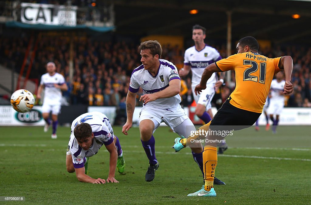 Kwesi Appiah of Cambridge scores his and the teams second goal of the game during the Sky Bet League Two match between Cambridge United and Oxford United at The Abbey Stadium on October 11, 2014 in Cambridge, England.