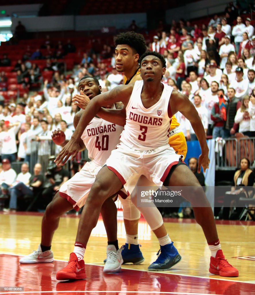 Kwinton Hinson #40 and Robert Franks #3 of the Washington State Cougars box out Justice Sueing #10 of the California Golden Bears after a free throw in the second half at Beasley Coliseum on January 13, 2018 in Pullman, Washington. Washington State defeated California 78-53.