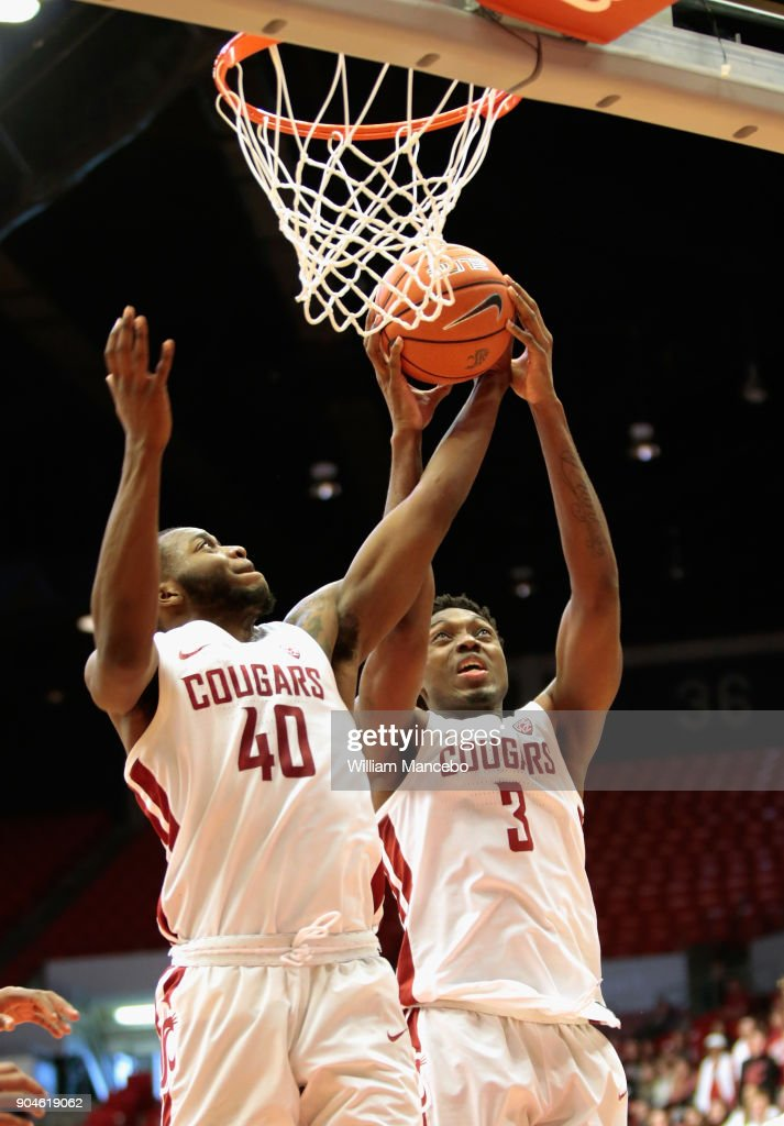 Kwinton Hinson #40 and Robert Franks #3 of the Washington State Cougars go up for a rebound against the California Golden Bears in the second half at Beasley Coliseum on January 13, 2018 in Pullman, Washington. Washington State defeated California 78-53.