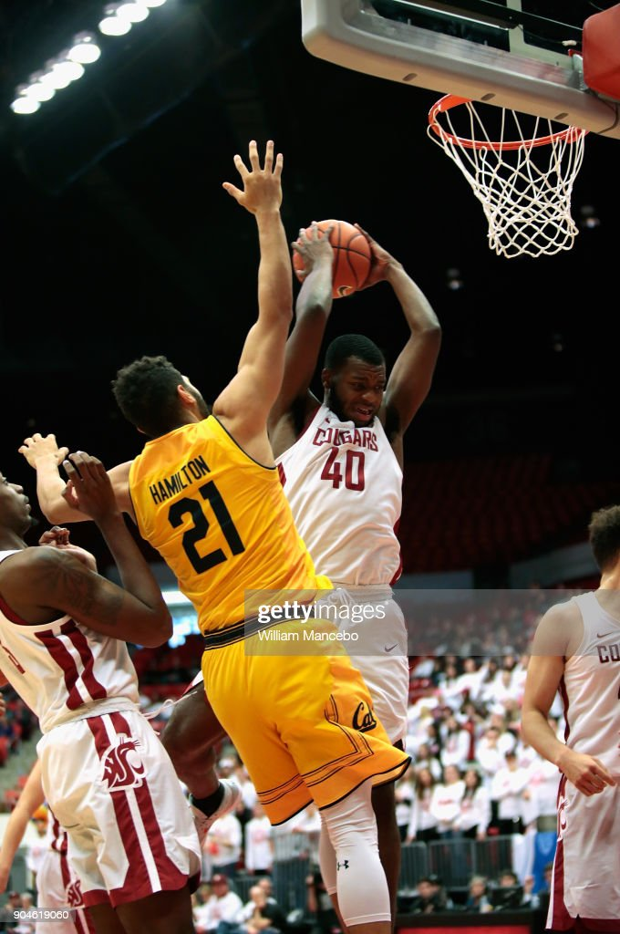 Kwinton Hinson #40 of the Washington State Cougars controls a rebound against Nick Hamilton #21 of the California Golden Bears in the second half at Beasley Coliseum on January 13, 2018 in Pullman, Washington. Washington State defeated California 78-53.