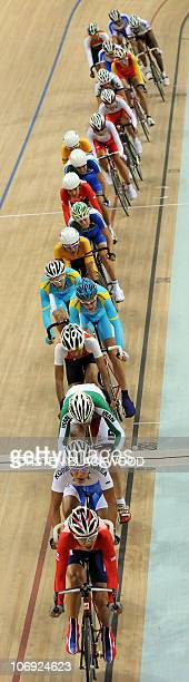 Kwok Ho Ting of Hong Kong leads a conga line of competitors during the men's points race cycling final at the 16th Asian Games in Guangzhou on...