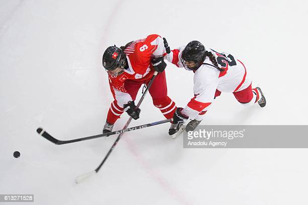 Kwok Hoi Kei of Hong Kong and Betul Kahraman of Turkey in action during a match between Turkey and Hong Kong as part of the IIHF Womens Olympic...