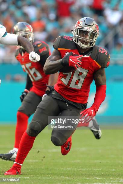 Kwon Alexander of the Bucs makes an interception and then runs the ball upfield during game between the Tampa Bay Buccaneers and the Miami Dolphins...