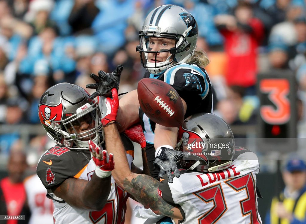 Kwon Alexander #58 of the Tampa Bay Buccaneers intercepts a pass to Brenton Bersin #11 of the Carolina Panthers in the third quarter during their game at Bank of America Stadium on December 24, 2017 in Charlotte, North Carolina.