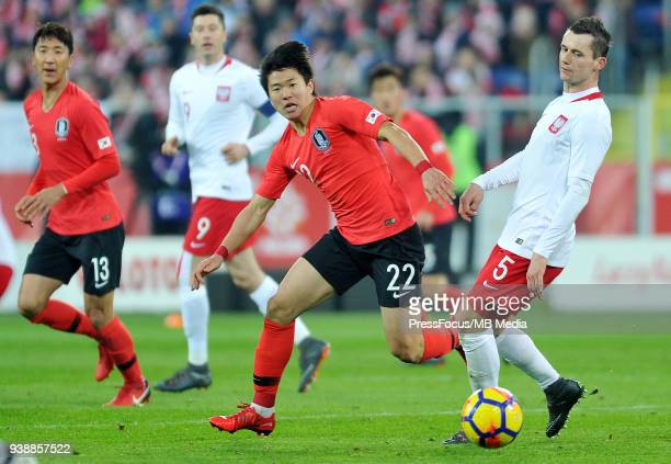 Kwon Chang-Hoon of Korea Republic competes with Krzysztof Maczynski of Poland during international friendly match between Poland and Korea Republic...