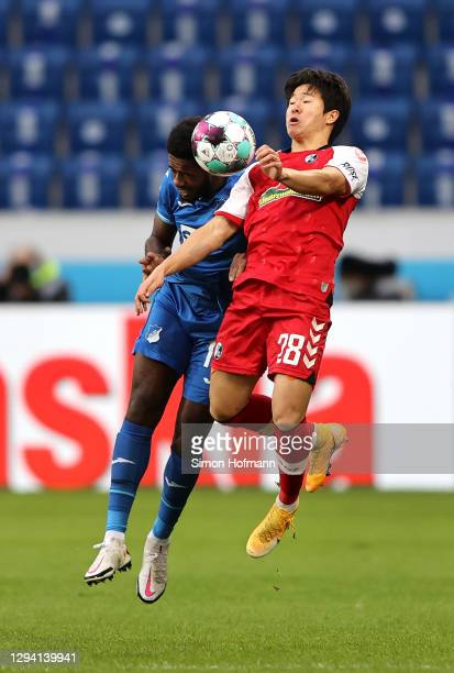 Kwon Chang-Hoon of SC Freiburg and Ryan Sessegnon of TSG 1899 Hoffenheim contest a header during the Bundesliga match between TSG Hoffenheim and...