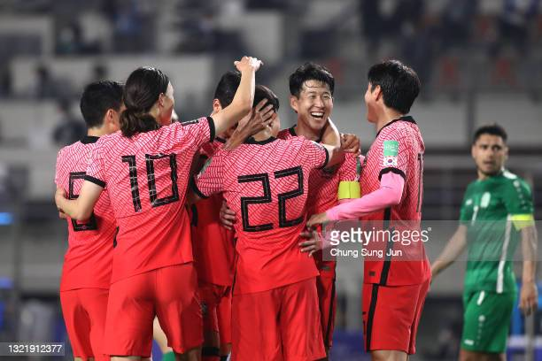 Kwon Chang-Hoon of South Korea celebrates with Son Heong-Min and Lee Jae-Sung after scores a team's fourth goal during the FIFA World Cup Asian...