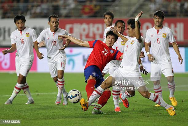 Kwon Chang-Hoon of South Korea compete for the ball with Hanevila Khamphoumy of Laos during the 2018 FIFA World Cup Qualifier Round 2 - Group G match...