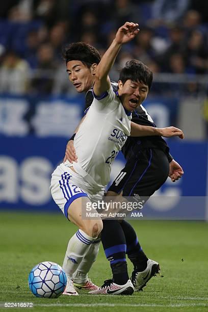 Kwon Chang-hoon of Suwon Samsung Bluewings and Koki Yonekura of Gamba Osaka during the AFC Champions League Group G match between Gamba Osaka and...