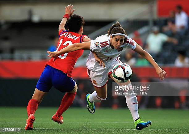Kwon Hahnul of Korea Republic and Vicky Losada of Spain challenge for the ball during the FIFA Women's World Cup 2015 Group E match between Korea...