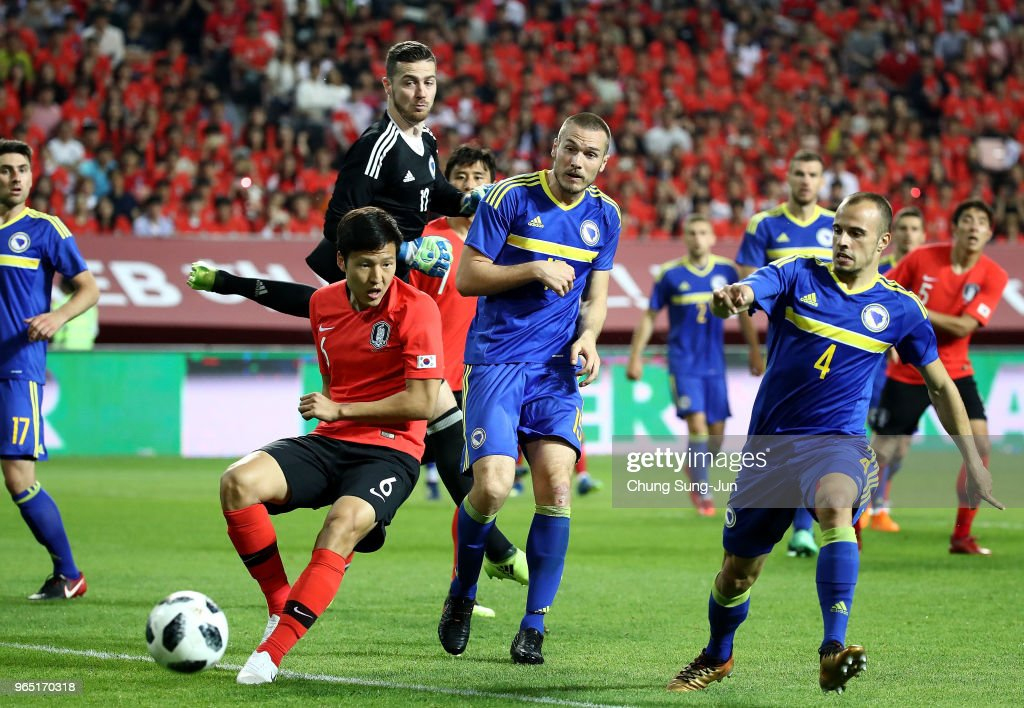 Kwon Kyung-Won of South Korea competes for the ball with Darko Todorovic Bosnia & Herzegovina during the international friendly match between South Korea and Bosnia & Herzegovina at Jeonju World Cup Stadium on June 1, 2018 in Jeonju, South Korea.