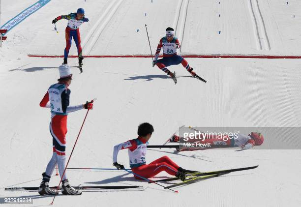 Kwon Sanghyeon of Sourh Kotea atumbles over the line at the end of the Men's Cross Country 10km Classic Standing on day eight of the PyeongChang 2018...