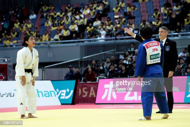 Kwon Youjeong of South Korea reacts as she wins after Tsukasa Yoshida of Japan committed a foul in the Women's 57kg bronze medal match on day two of...