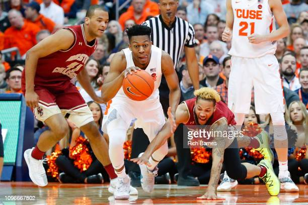 Ky Bowman of the Boston College Eagles dives for the ball controlled by Tyus Battle of the Syracuse Orange during the second half at the Carrier Dome...