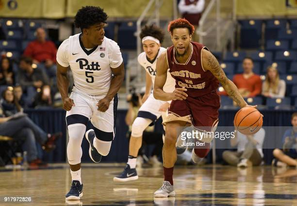 Ky Bowman of the Boston College Eagles dribbles against Marcus Carr of the Pittsburgh Panthers in the second half during the game at Petersen Events...