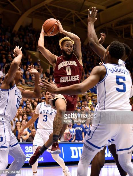 Ky Bowman of the Boston College Eagles looks to pass between Javin DeLaurier and RJ Barrett of the Duke Blue Devils during the first half of their...