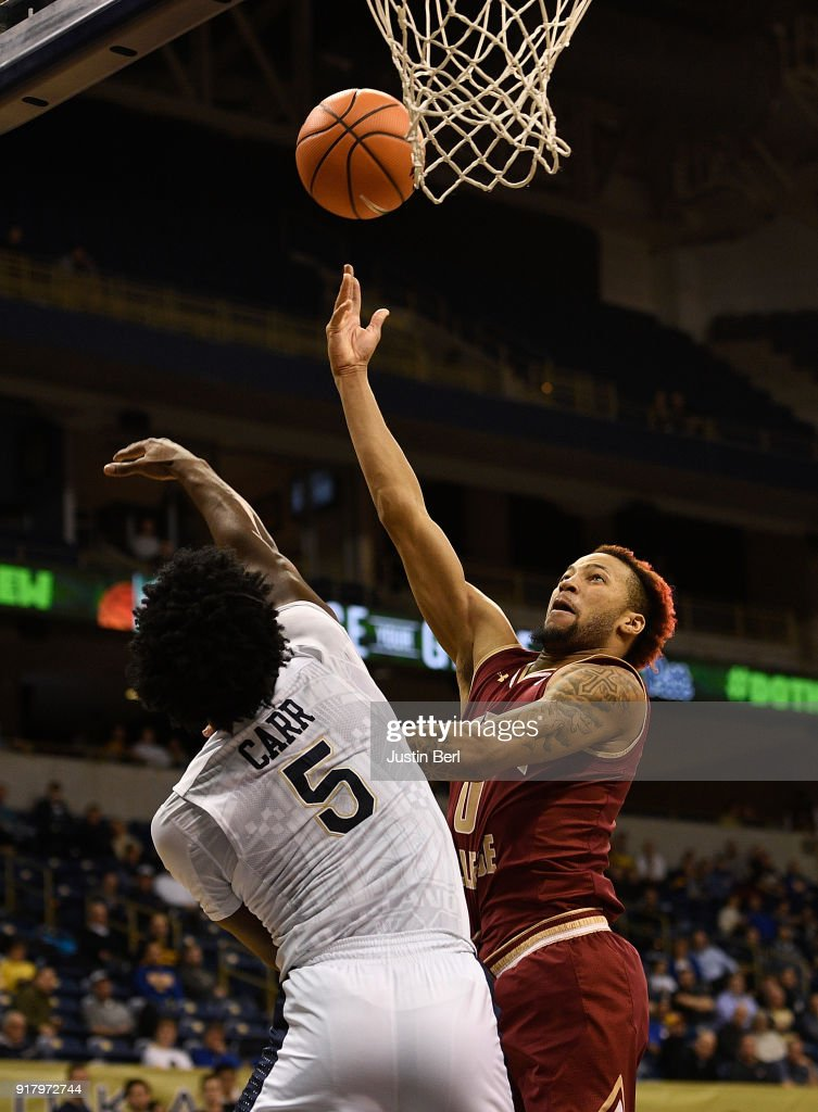Ky Bowman #0 of the Boston College Eagles puts up a shot over Marcus Carr #5 of the Pittsburgh Panthers in the second half during the game at Petersen Events Center on February 13, 2018 in Pittsburgh, Pennsylvania.