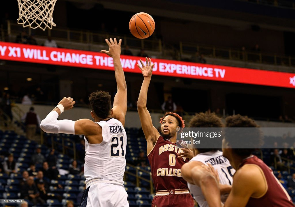 Ky Bowman #0 of the Boston College Eagles puts up a shot over Terrell Brown #21 of the Pittsburgh Panthers in the first half during the game at Petersen Events Center on February 13, 2018 in Pittsburgh, Pennsylvania.