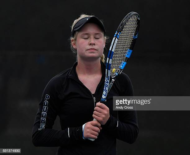 Ky Ecton Poudre takes a deep breath and closes her eyes during her state final match against opponent Seraphin Castelino Fairview at the Gates Tennis...