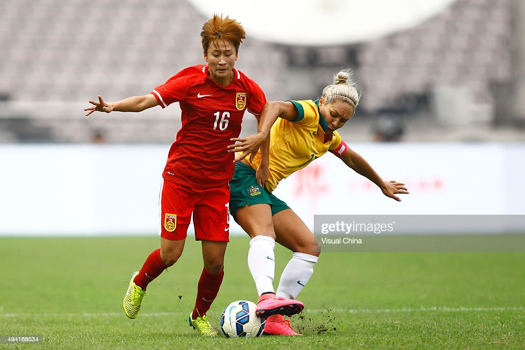 Kyah Simon #17 of Australia and Lou Jiahui #16 of China compete for the ball in the match between China and Australia during the 2015 Yongchuan Women's Football International Matches at Yongchuan Sports Center on October 25, 2015 in Yongchuan, Chongqing of China.