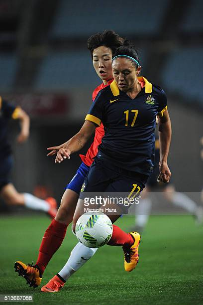 Kyah Simon of Australia controls the ball under pressure of Kim Hye Ri of South Korea during the AFC Women's Olympic Final Qualification Round match...