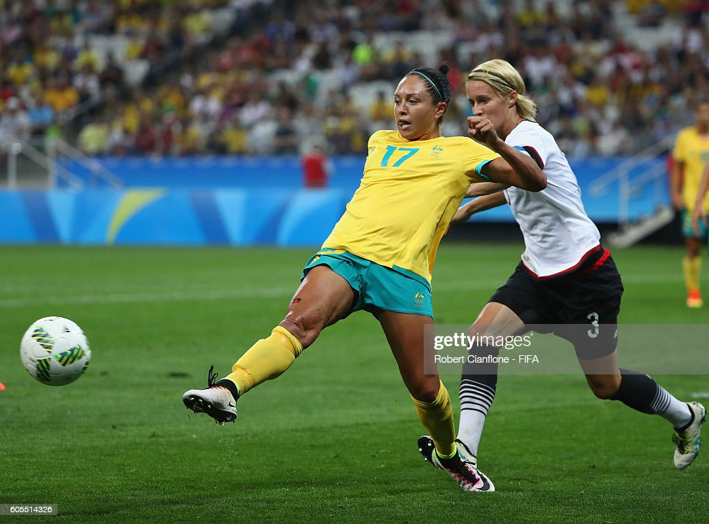 Kyah Simon of Australia is challenged by Saskia Bartusiak of Germany during the Women's First Round Group F match between Germany and Australia on Day 1 of the Rio 2016 Olympic Games at Arena Corinthians on August 6, 2016 in Sao Paulo, Brazil.