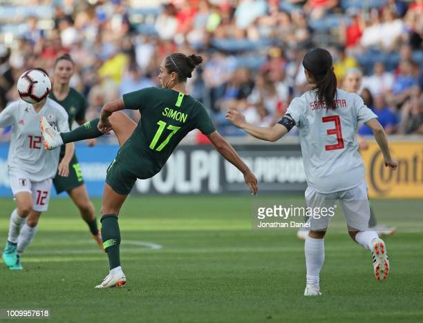 Kyah Simon of Australia passes the ball in front of Aya Sameshima of Japan during the 2018 Tournament Of Nations at Toyota Park on August 2 2018 in...