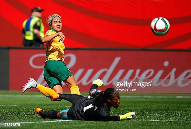 Kyah Simon of Australia scores a goal past goalkeeper Precious Dede of Nigeria during the FIFA Women's World Cup Canada 2015 match between Australia...