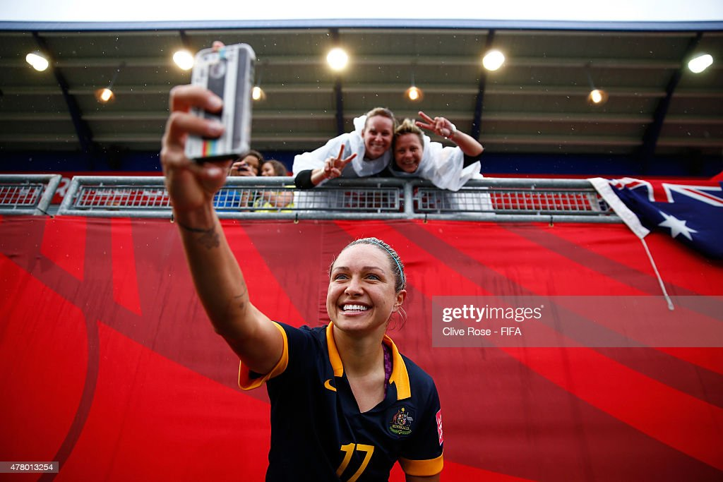 Kyah Simon of Australia takes a 'selfie' after the FIFA Women's World Cup 2015 Round of 16 match between Brazil and Australia at Moncton Stadium on June 21, 2015 in Moncton, Canada.