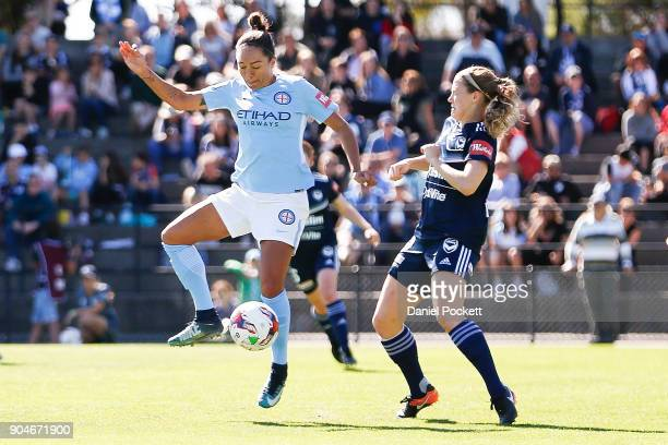 Kyah Simon of Melbourne City and Kristen McNabb of Melbourne Victory contest the ball during the round 11 WLeague match between the Melbourne Victory...