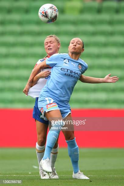 Kyah Simon of Melbourne City and Libby Copus-Brown of the Jets compete for the ball during the round 10 W-League match between Melbourne City and the...