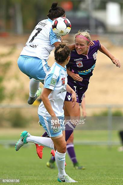 Kyah Simon of Sydney and Nicole Stanton of the Glory contest a header during the round six WLeague match between the Perth Glory and Sydney FC at...