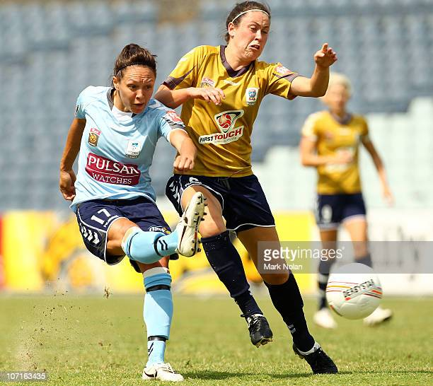 Kyah Simon of Sydney takes a shot at goal as Renee Cartwright of the Jets defends during the round four W-League match between Sydney FC and the...