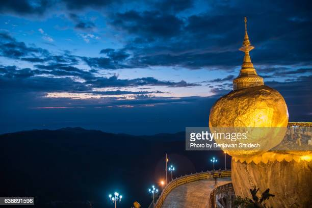 kyaiktiyo pagoda (golden rock) at dusk, mon state, myanmar - myanmar culture stock pictures, royalty-free photos & images