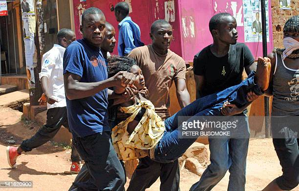 A Kyambogo University student who suffocated after inhaling teargas is carried by fellow students in Kampala on March 20 2012 Students from Nkumba...
