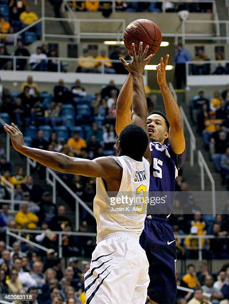 Kyan Anderson of the TCU Horned Frogs pulls up for a shot against Juwan Staten of the West Virginia Mountaineers during the game at the WVU Coliseum...