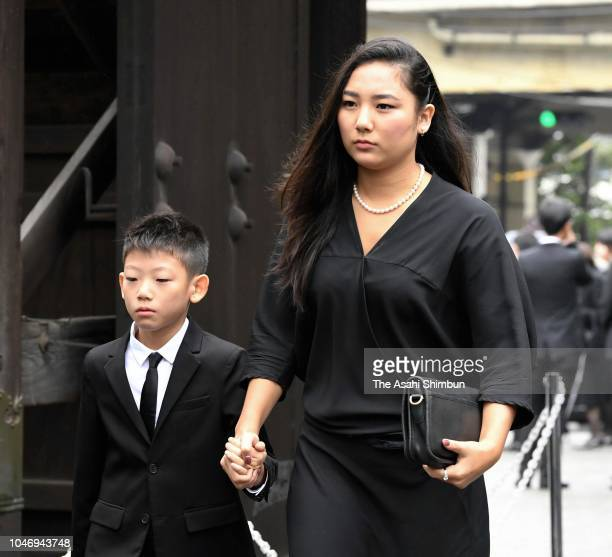 Kyara Uchida and Gento Uchida grandchildren of late actress Kirin Kiki attend the funeral at Korinji Temple on September 30 2018 in Tokyo Japan