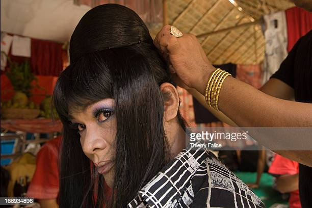 Kyauw Thu Ya a medium is getting made up and dressed before dancing Every year in August hundreds of thousands of people from all over Myanmar gather...