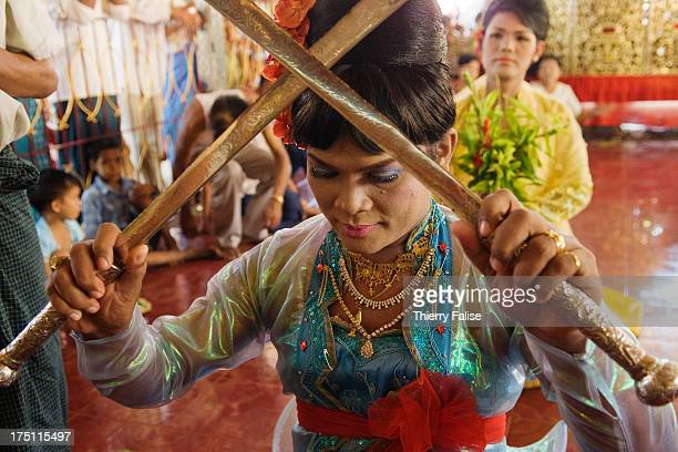 Kyauw Thu Ya a medium performs the Taungbyon Brothers dance with swords Every year in August hundreds of thousands of people from all over Myanmar...