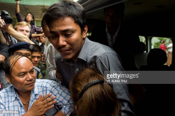 Kyaw Soe Oo a journalist for the Reuters newswire hugs his sister upon his arrival at a court in Yangon on December 27 2017 Two Myanmar journalists...