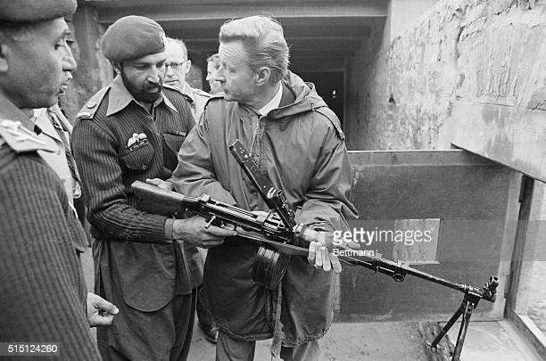 United States Security Adviser Zbigniew Brzezinski looks into Afghanistan through the sights of a machine gun at a Pakistan Army outpost here on the...